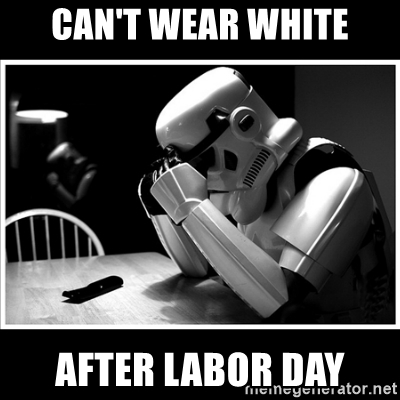 Star Wars storm trooper in white armor looking disconsolate.