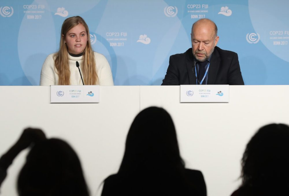 Climate expert and activist James Hansen and his granddaughter Sophie Kivlehan, who was among 21 young plaintiffs in the federal lawsuit Juliana vs. U.S. Government, speak at a press conference at the COP 23 United Nations Climate Change Conference on Nov. 6, 2017 in Bonn, Germany. Credit: Sean Gallup/Getty Images