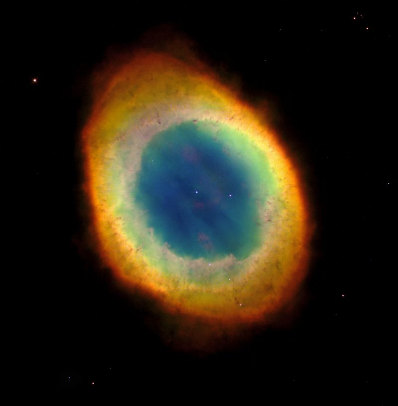 Deep-sky objects: A colorful oval cloud in space, blue in the middle to orange and red on the outskirts.