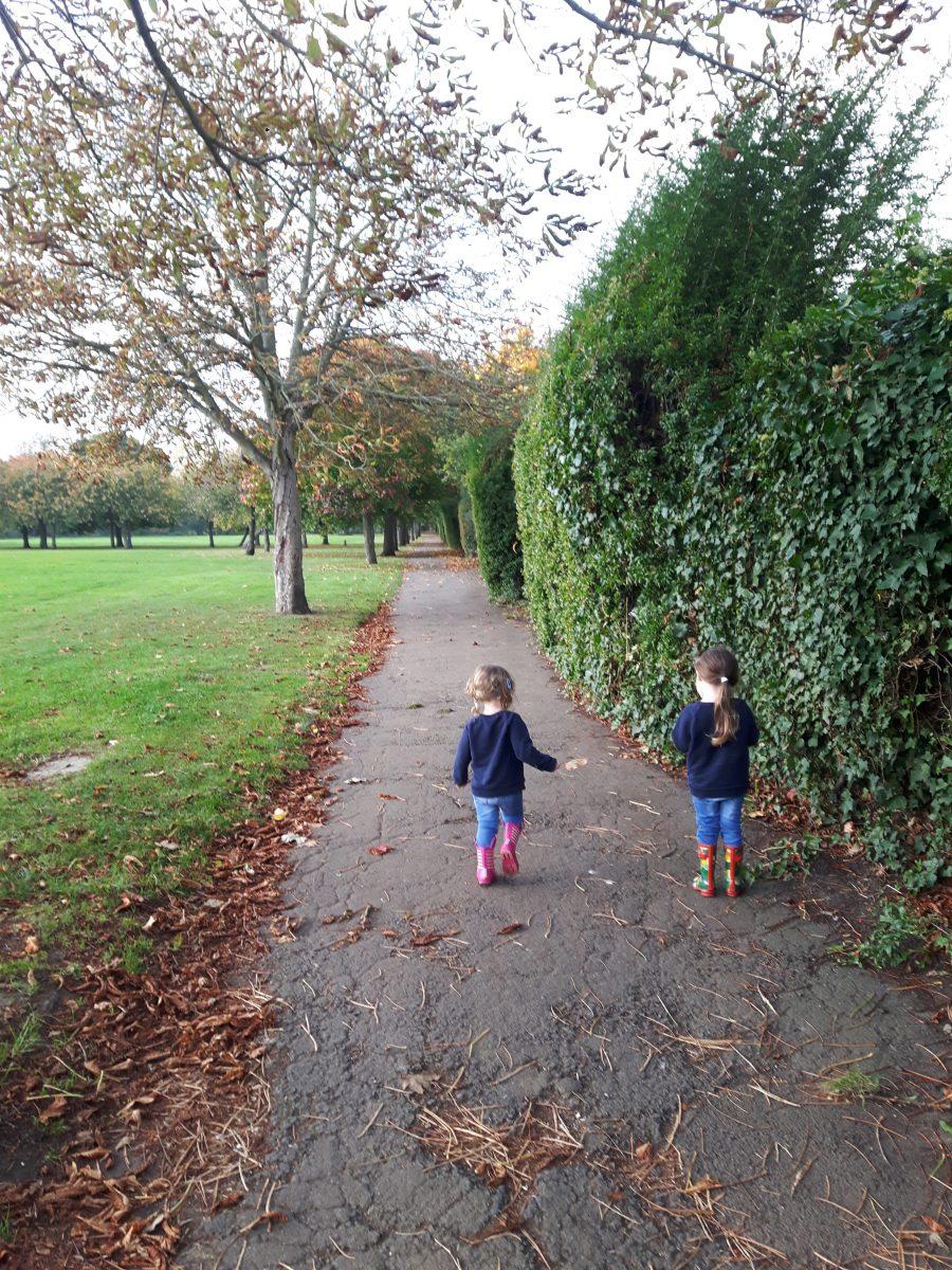 bilingual language -children walking on path through park