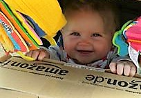 Minority target language resources -Baby holding Amazon package