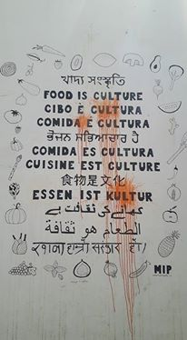 the role of food in raising bilingual children - Food is culture mural in Lisbon.