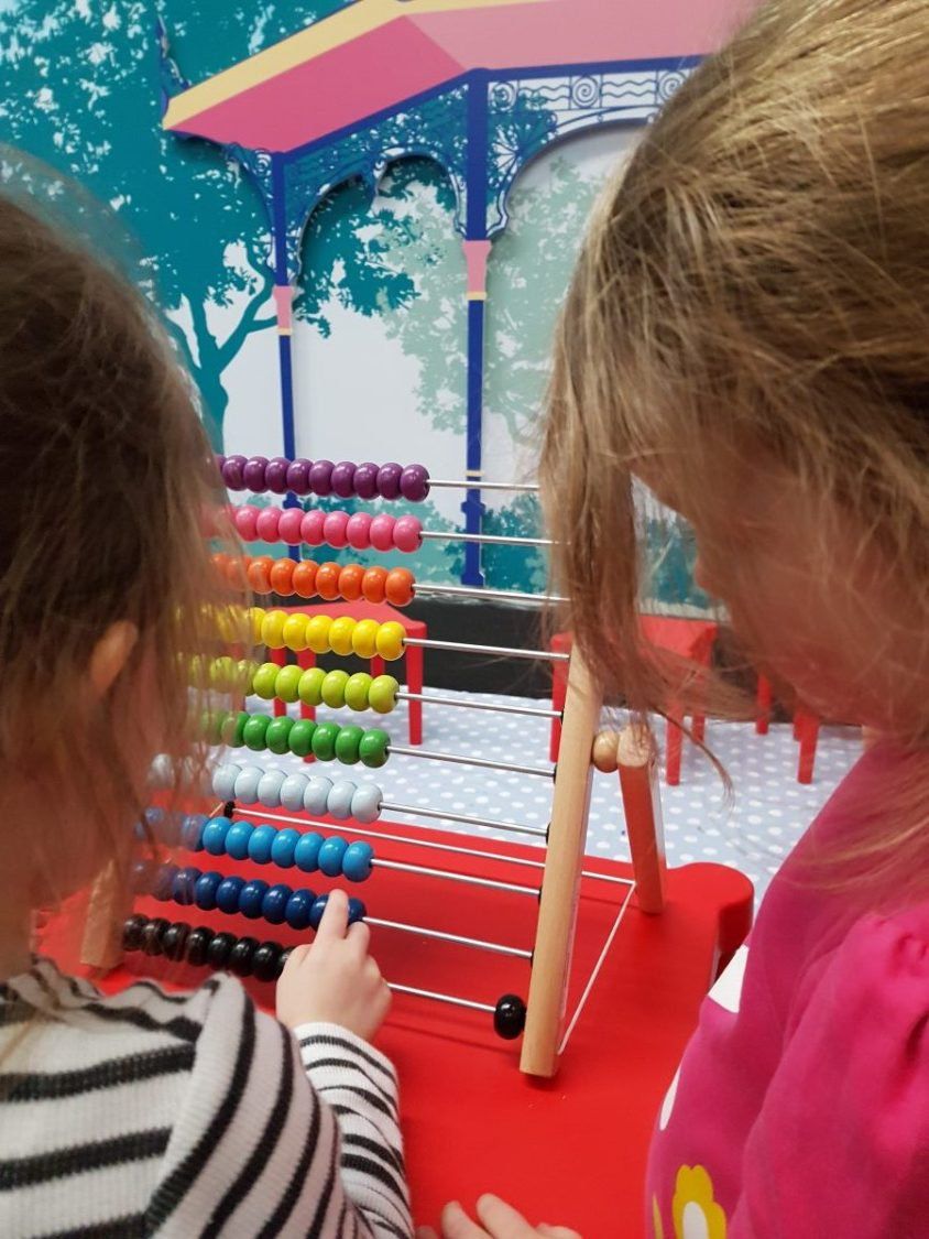 children playing with abacus STEM week