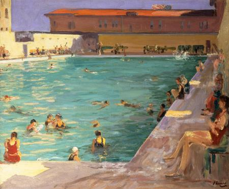 various people swimming and lounging around public pool