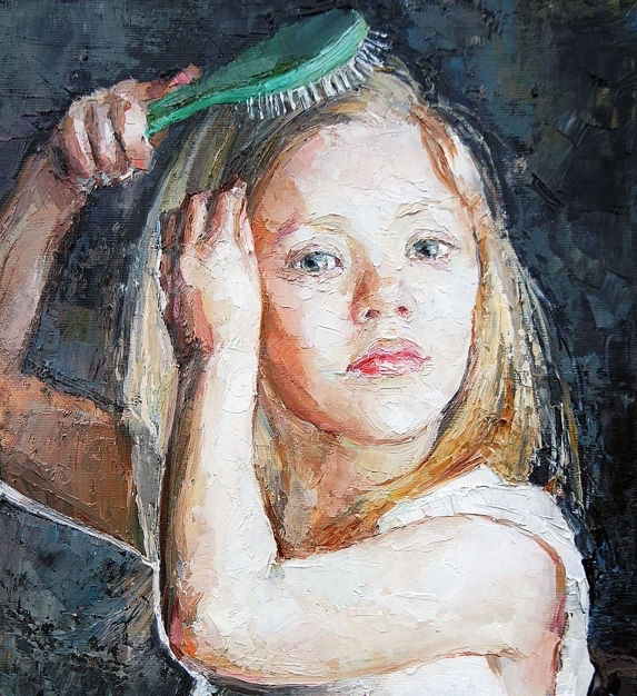 young blonde girl brushes her hair