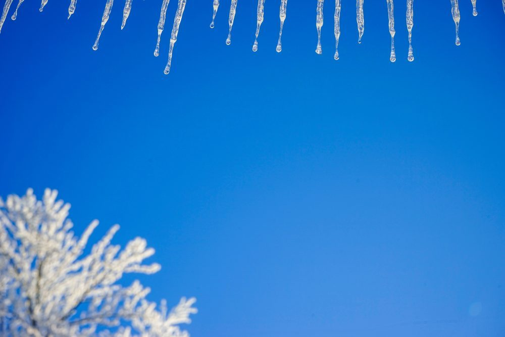 icicles in a blue sky