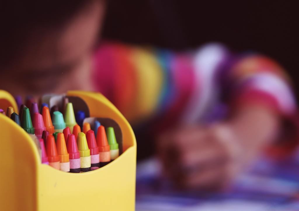 box of crayons in forefront