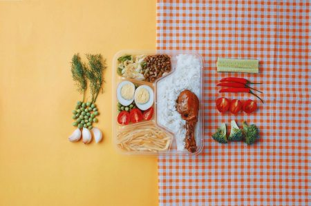 lunch boxes on colourful backgrounds