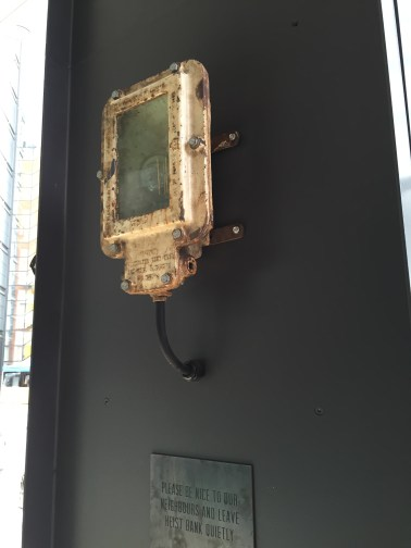 Reclaimed shipping flood light reinstated by Moth lighting
