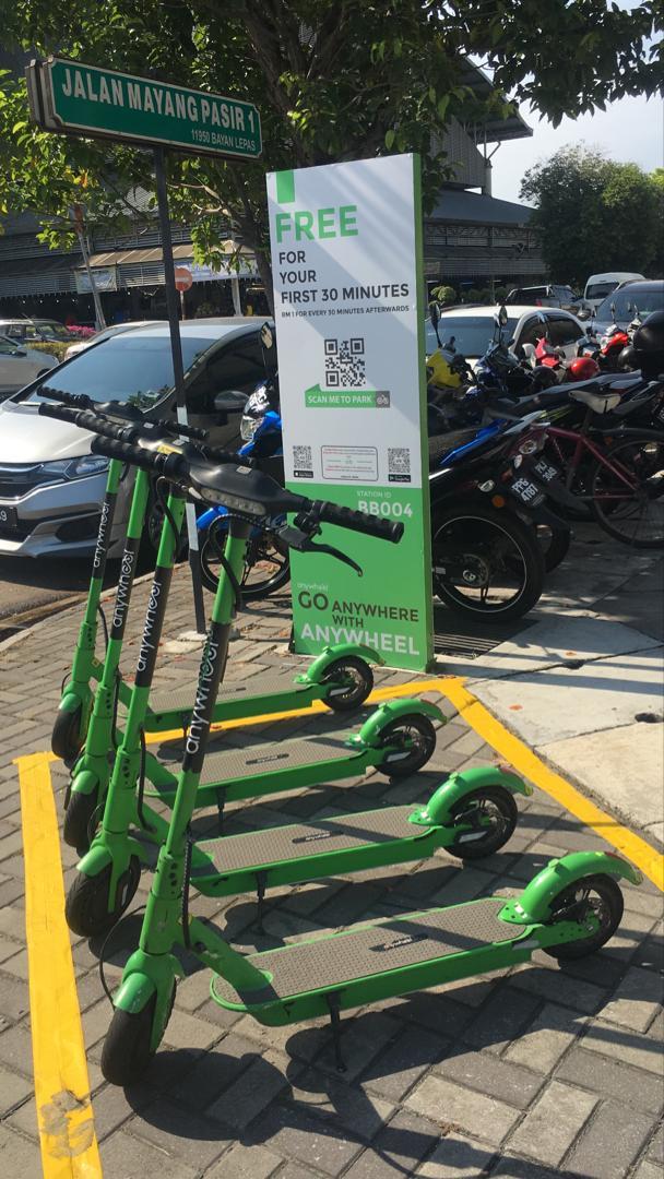 Anywheel Electric scooter sharing in Bayan Baru Penang station pylon and yellow box