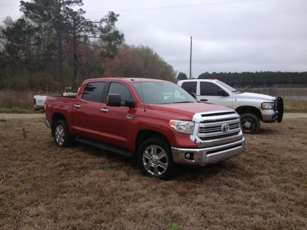 Exhibit C: 2014 Tundra on a farm along with farm trucks.