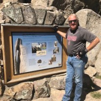 Mike at a sign about Crazy Horse Monument