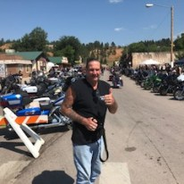 Greg with alot of motorcycles