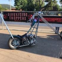 Chopper motorcycle rigid frame purple coffin tank