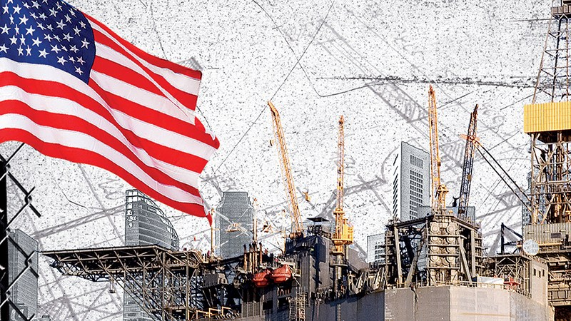 Construction Cranes with an American Flag