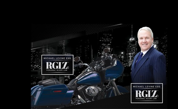 Mike Levine with a blue motorcycle in NYC