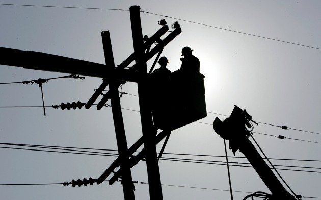 Utility workers fixing downed lines