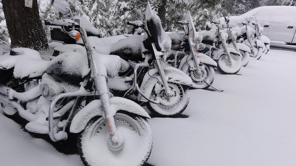 Motorcycles covered in snow and ice