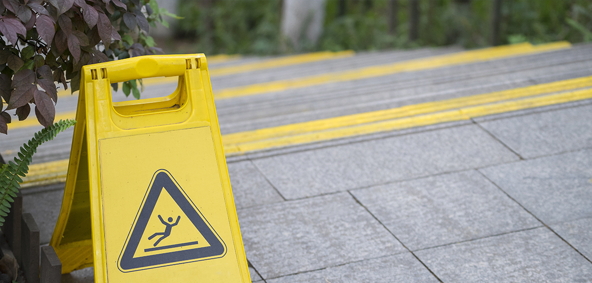 grey steps with a yellow warning sign