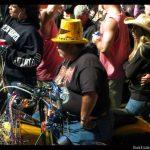 Biker wearing a yellow on sitting on a yellow bike