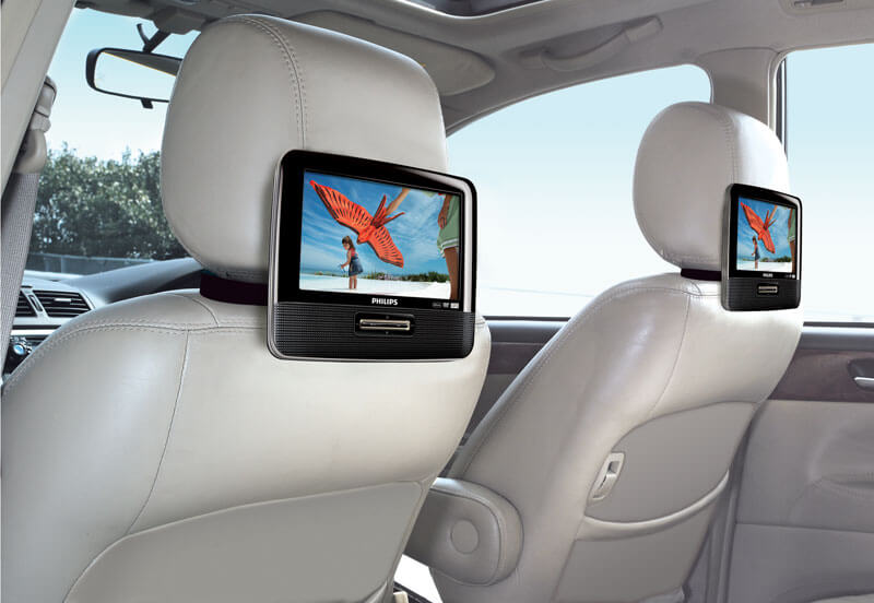 mobile video and audio player mounted on a car headrest