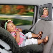 A baby car mirror installed in a car with a headrest