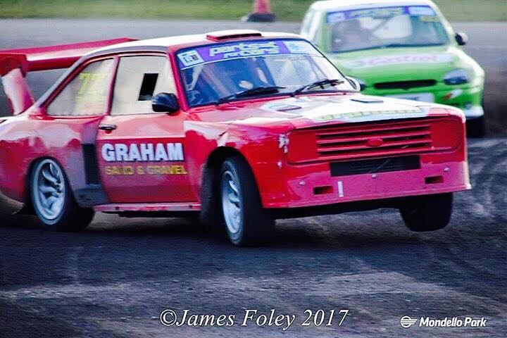 Tommy Graham cocks a wheel during his epic Modified class battle with Willie Coyne Image from James Foley