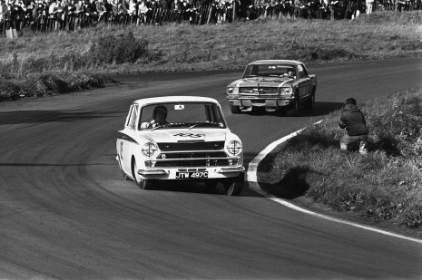 1965 British Saloon Car Championship. Oulton Park, Cheshire, England. 18th September 1965. Rd 8. Jim Clark (Lotus Ford Cortina), 2nd position, leads Jack Brabham (Ford Mustang), 1st position, action. World Copyright: LAT Photographic. Ref: L65 - 488-30A.