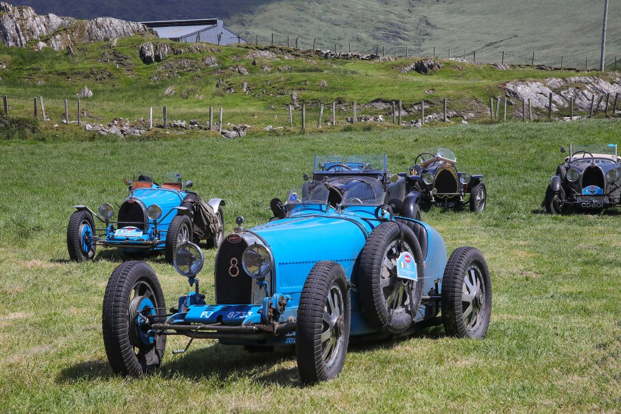 Bugatti Tour Meeting driving through Allihies Village Beara Peninsula. International Bugatti Meetings are held in a rotation through Europe. In 2019 the meeting based at the Dunloe Castle, Killarney, toured the peninsulas of West Cork and Kerry. Driving the Wild Atlantic Way. The most iconic and valuable Bugatti cars celebrates its 110th anniversary. Frenchman Ettore Bugatti created the first engineering art form of car manufacturing in 1909. The symbolic racing cars are worth millions of euro.Photo:Valerie O'Sullivan©