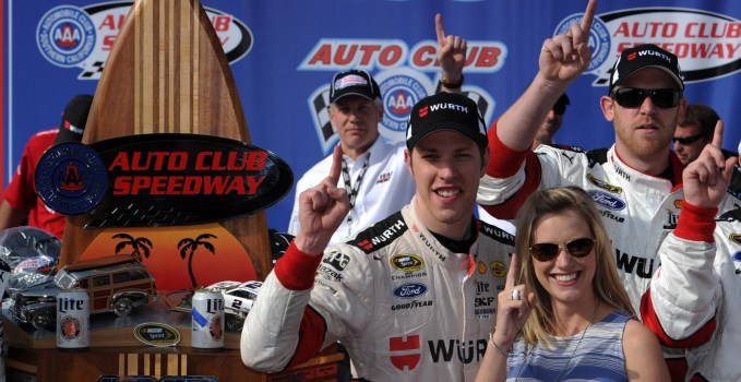Brad Keselowski celebrates in Victory Lane with girlfiend Paige White after winning the Auto Club 400 at Auto Club Speedway.