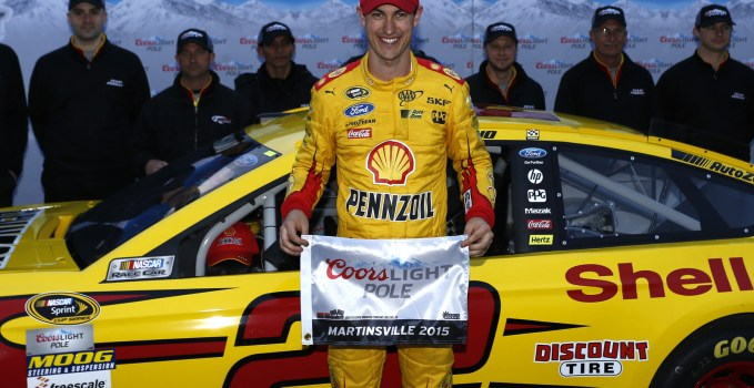 Joey Logano poses with the Coors Light Pole Award after winning the pole for the STP 500 at Martinsville Speedway.