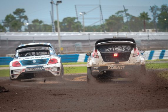 Patrik Sandell fights to the inside of Scott Speed in the mud during the first Red Bull Global Rallycross Supercars final at Daytona International Speedway on June 18, in Daytona Beach, FL