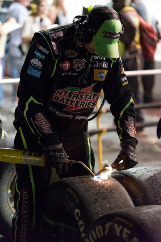 A crew member for the 18 of Kyle Busch checks the tires after a long green flag run during the 2016 Southern 500 in Darlington, Sc, Sunday, September 4, 2016.