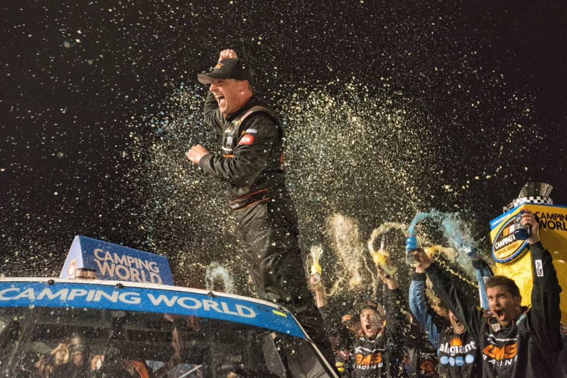 Johny Sauter (21) celebrates after winning the Ford Ecoboost 200 at Homestead-Miami Speedway.