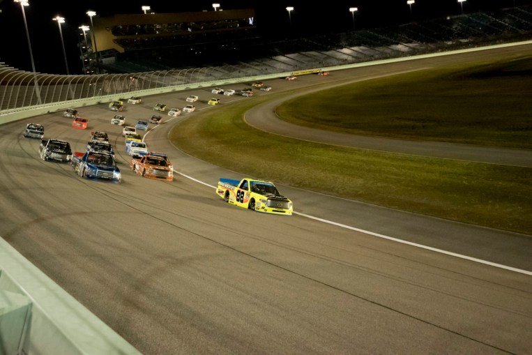 The field running through turn 2 during the Ford Ecoboost 200 at Homestead-Miami Speedway.