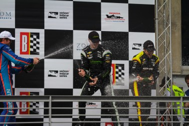 Scott Dixon, Josef Newgarden and Simon Pagenaud celebrate their podium finishes with champagne after the Honda Indy Grand Prix of Alabama at Barber Motorsports Park on April 23, 2017.
