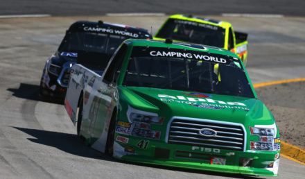 MARTINSVILLE, VA - MARCH 26:  Ben Rhodes, driver of the #41 Alpha Energy Solutions Ford, leads a pack of trucks during the weather delayed NASCAR Camping World Truck Series Alpha Energy Solutions 250 at Martinsville Speedway on March 26, 2018 in Martinsville, Virginia.  (Photo by Sarah Crabill/Getty Images)