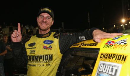 LAS VEGAS, NV - SEPTEMBER 14:  Grant Enfinger, driver of the #98 Ford, apllies the winner's sticker in Victory Lane after winning the NASCAR Camping World  Truck Series World of Westgate 200 at Las Vegas Motor Speedway on September 14, 2018 in Las Vegas, Nevada.  (Photo by Matt Sullivan/Getty Images)