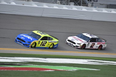 Penske duo Ryan Blaney (12) and Brad Keselowski (2) working together at the front of the pack.