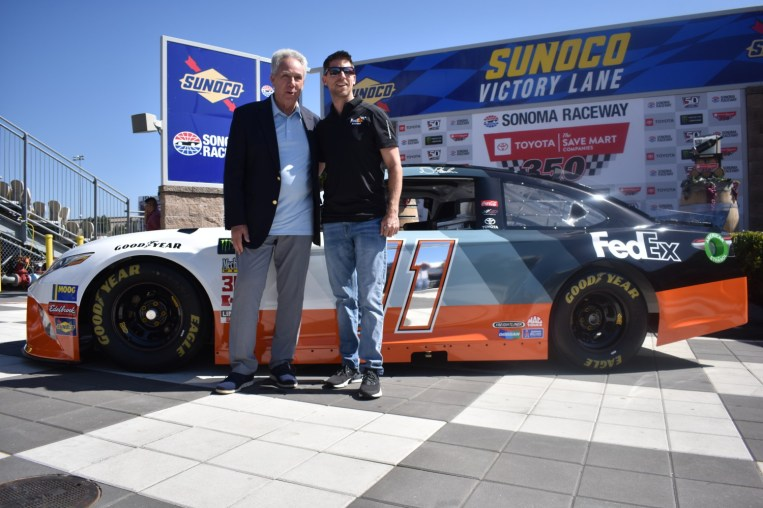 Denny Hamlin and FedEx unveiled their throwback paint scheme for this year's Bojangles' Southern 500 at Darlington Raceway, honoring Darrell Waltrip.