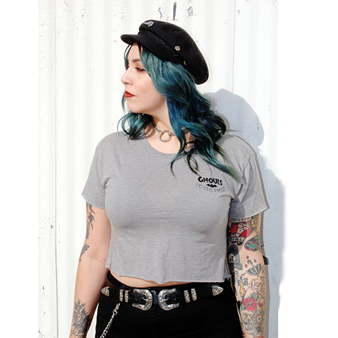 Alternative model, woman with tattoos and green hair wearing ghoulds she wolf vegan motorcycle co tshirt