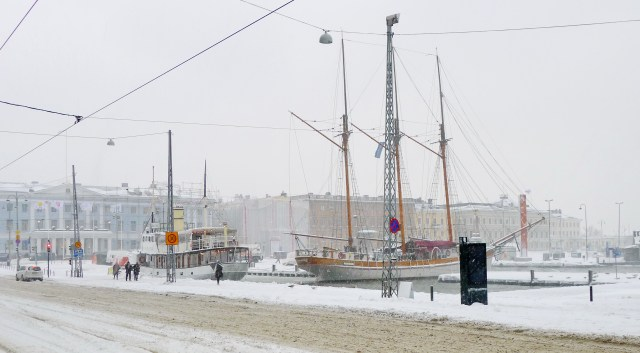 Two ships, one with three masts, in harbour in winter