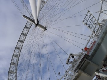 Looking up at the sky through the giant wheel of the London Eye
