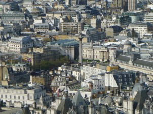 Many buildings crowded together, seen from above, with the National Gallery and Nelson's Column recognizable in the centre