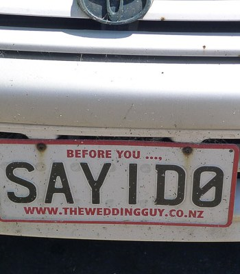 SAY I DO – In New Zealand, the vanity plates can be highly customized. This wedding planner has his website URL on the plate.