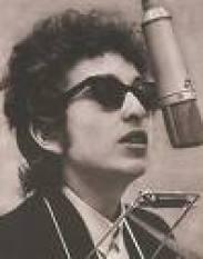 Bob Dylan, su guitarra y su harmónica
