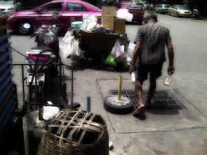Elderly man recycle work
