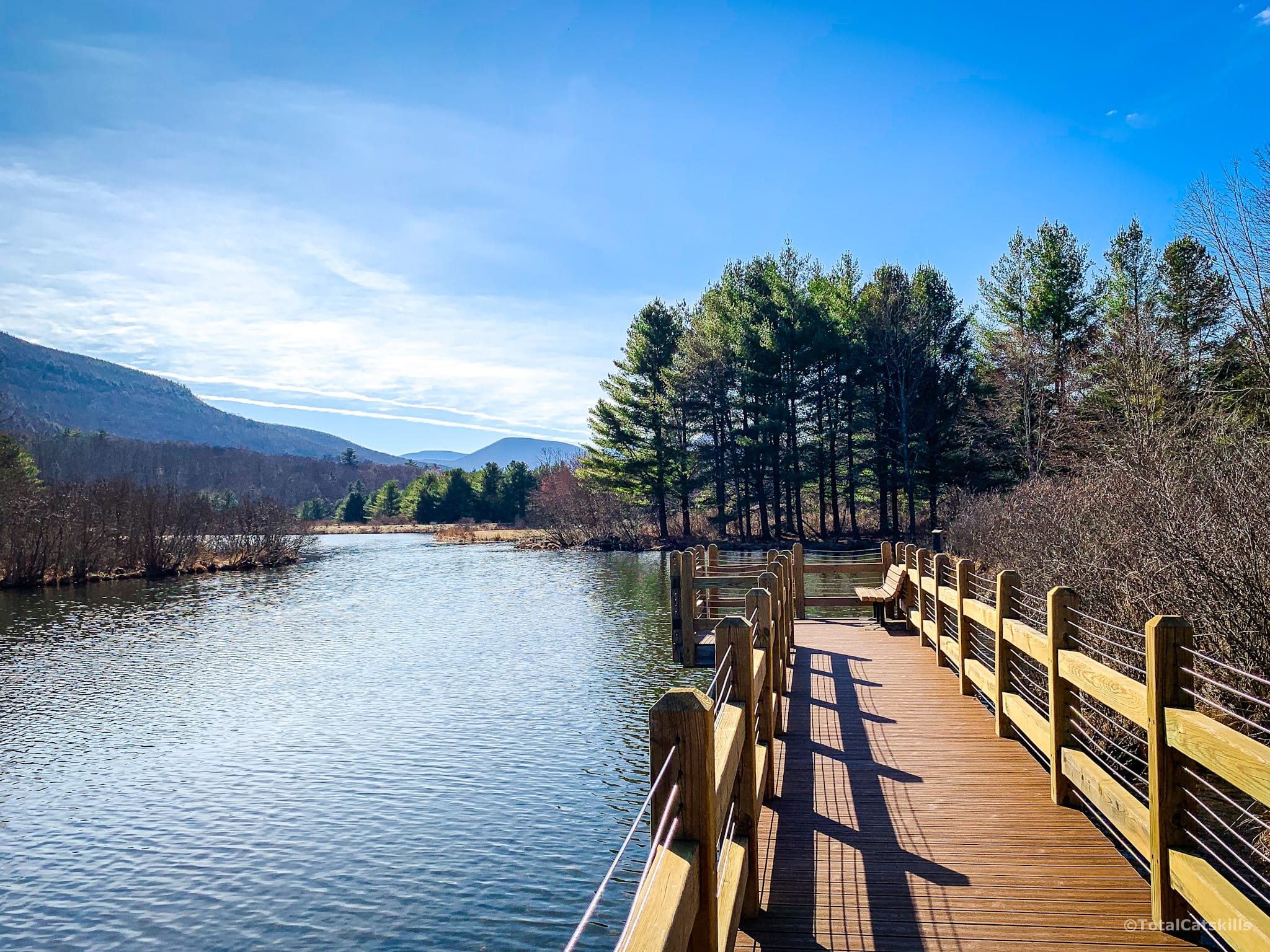 fishing dock, pond, mountains, trees, catskills