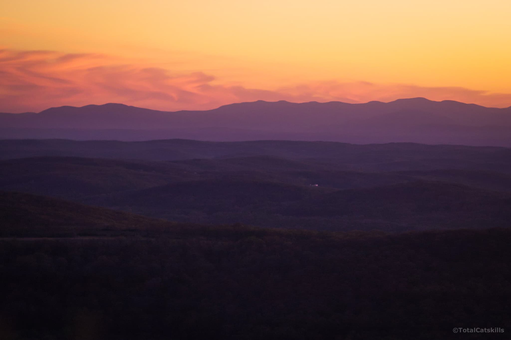mountain range in distance at sunset