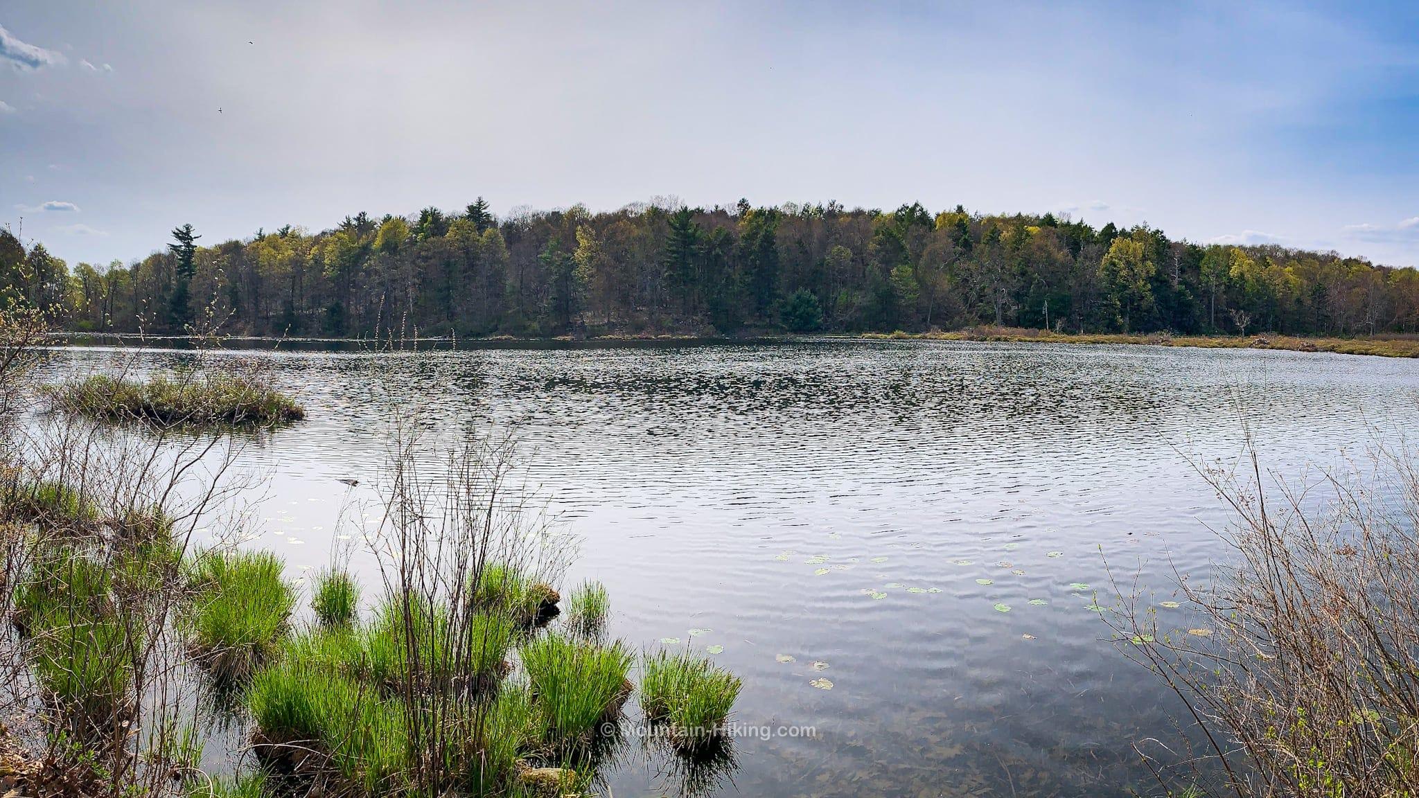 calm beaver pond and low mountain ridge